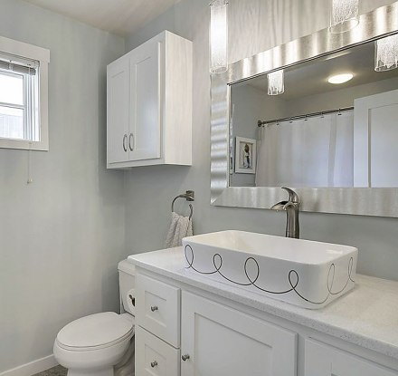 light gray and white bathroom with painted sink